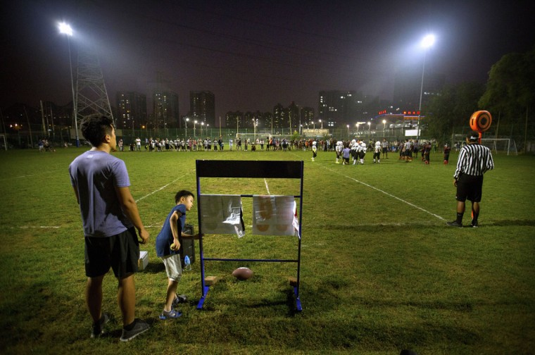 A young spectator checks the scoreboard during an American football game in Beijing. Chinaís capital might seem like an unlikely place to find American football, but interest among Chinese youth is growing. (AP Photo/Mark Schiefelbein)