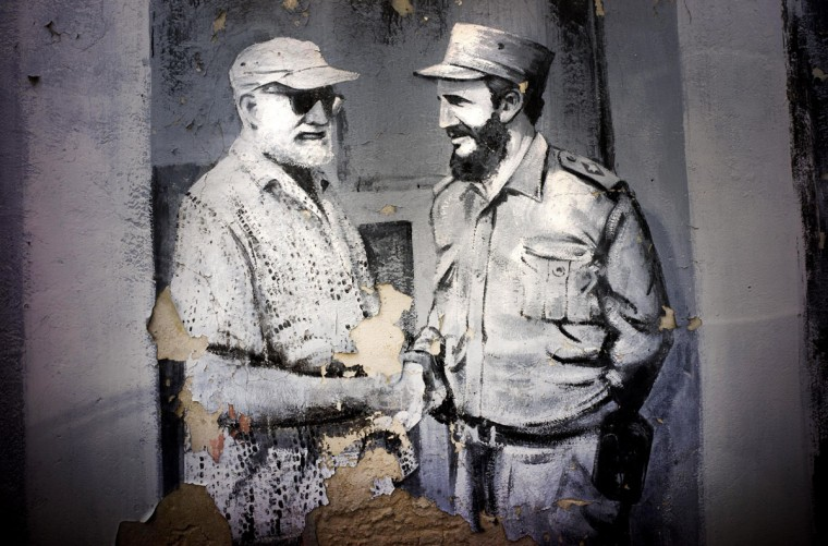A mural featuring American author and journalist Ernest Hemingway shaking hands with Fidel Castro decorates a wall in a downtown parking lot in Havana, Friday, July 17, 2015. Washington and Havana plan to officially restore diplomatic relations on Monday with the reopening of their embassies. (AP Photo/Ramon Espinosa)