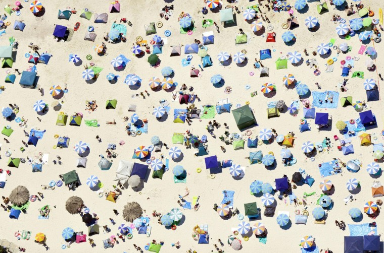 Umbrellas and beach-goers pack a beach in Shirahama town, Wakayama prefecture, western Japan on the Marine Day national holiday Monday, July 20, 2015. (Kyodo News via AP)