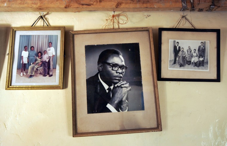 FILE - In this Thursday, Feb. 5, 2008 file photo, a photograph of Barack Obama Sr., father of President Barack Obama, hangs on the wall of his step-grandmother Sarah Obama's house in the village of Kogelo, near the shores of Lake Victoria, in Kenya. On Friday, July 24, 2015 Obama is due to arrive in Kenya, the country of his father's birth, for the first time since he was a U.S. senator in 2006, and the first stop on his two-nation African tour in which he will also visit Ethiopia. (AP Photo/Ben Curtis, File)
