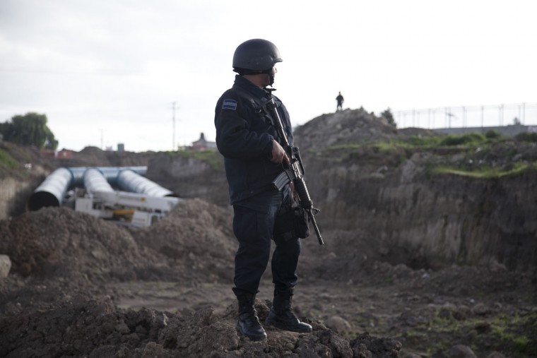 "A Federal police stands guard outside the maximum security prison Altiplano in Almoloya, west of Mexico City, Sunday, July 12, 2015. Mexico's most powerful drug lord, Joaquin ""El Chapo"" Guzman, escaped from a maximum security prison through a tunnel that opened into the shower area of his cell, the country's top security official announced. (AP Photo/Marco Ugarte)"