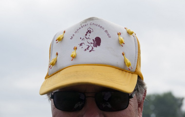 Lynn Heldt poses with his custom-made hat during the annual Manchester Chicken Broil in Manchester, Mich. Thursday, July 16, 2015. (Jessica Christian/The Jackson Citizen Patriot via AP)