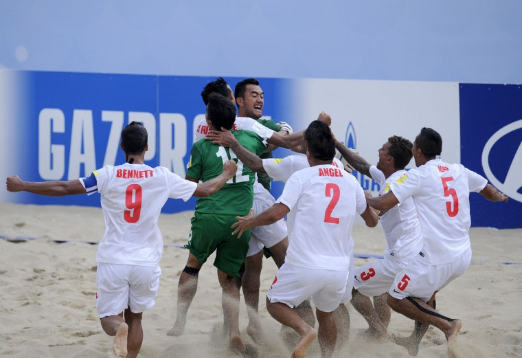 Tahiti's players celebrate after their victory over Italy during their FIFA Beach Soccer World Cup semi-final match in Espinho, Portugal, Saturday, July 18, 2015. Tahiti won on penalties 3-1 after a 6-6 draw. (AP Photo/Paulo Duarte)