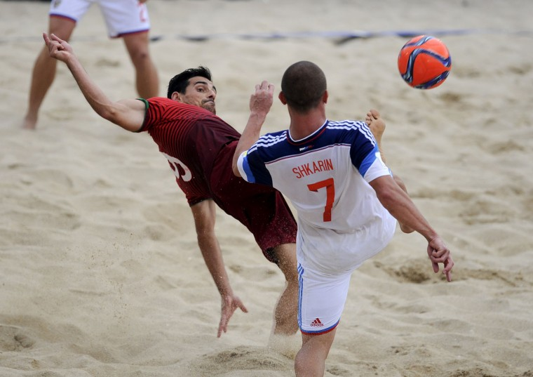 Russia's Shkarin, right, vies with Portugal's Bruno Novo for the ball during their FIFA Beach Soccer World Cup semi-final match in Espinho, Portugal, Saturday, July 18, 2015. Portugal won 4-2. (AP Photo/Paulo Duarte)