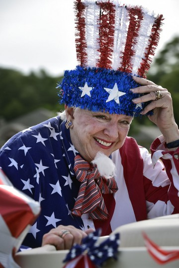 Jennifer Young, dressed as Uncle Sam, smiles from the back of her golf cart as she holds her hat in place Thursday, July 2, 2015, during the annual Independence Day Golf Cart Parade at Meadow Lake Senior Living Community in Tyler, Texas. Residents, staff and guests circled the complex in decorated golf carts, boats and by bicycle to celebrate the upcoming holiday. (Andrew D. Brosig/Tyler Morning Telegraph via AP)