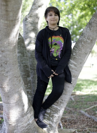 In this photo taken May 14, 2015, Alex Ramos, 13, who identifies as a transgender male, poses for a photograph in a park near his home in Homestead, Fla. Ramos realized in sixth grade he wasn't at peace with his biological female gender. He struggled to come to terms with it, afraid of how people at school would react. Ramos has since come out, and has the support of his mother and friends. (AP Photo/Lynne Sladky)