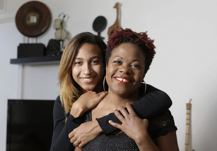 In this photo taken May 26, 2015, Kassandra Leach, 17, left, poses for a photograph with her mother, Renee Taylor, at their home in Miami. Leach, who identifies as a transgender female, says she never felt like one of the boys, and once in ninth grade she began experimenting with clothing, dressing more like a girl. In high school she lived her life secretly as a girl for over a year. Now out to her family and friends, she is transitioning with the help of counseling and hormones. (AP Photo/Lynne Sladky)