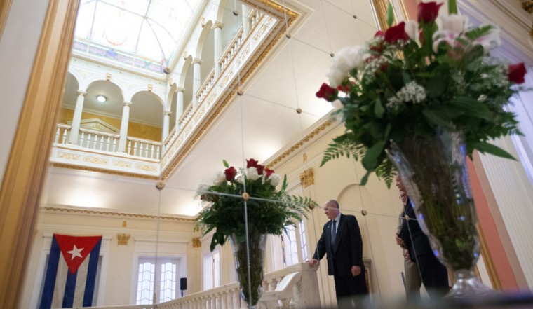 The last Cuban flag that was lowered from the Cuban Embassy in Washington on January 3, 1961 when relations between the United States and Cuba were severed, hangs in their new embassy in Washington, Monday, July 20, 2015. The United States and Cuba restored full diplomatic relations Monday after more than five decades of frosty relations rooted in the Cold War. (AP Photo/Andrew Harnik, Pool)