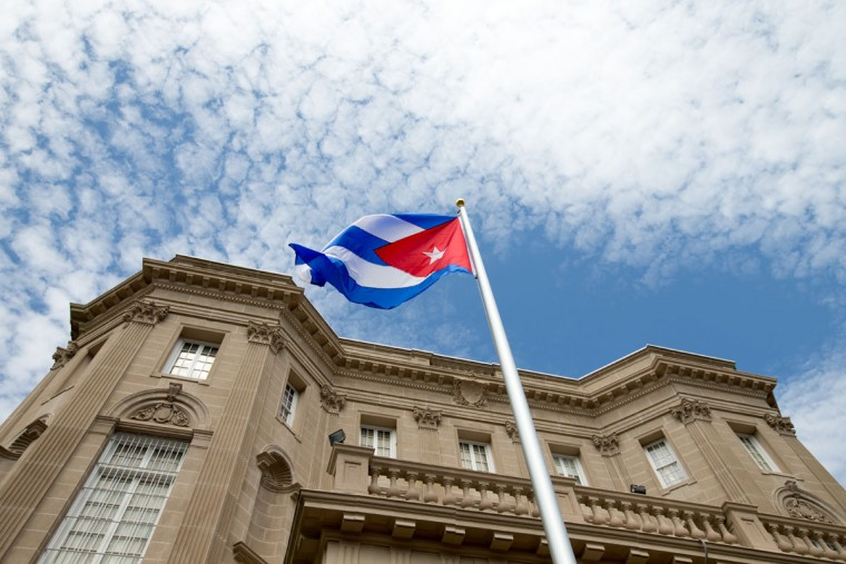 The Cuban flag is raised over their new embassy in Washington, Monday, July 20, 2015. Cuba's blue, red and white-starred flag was hoisted Monday at the country's embassy in Washington in a symbolic move signaling the start of a new post-Cold War era in U.S.-Cuba relations. (AP Photo/Andrew Harnik, Pool)