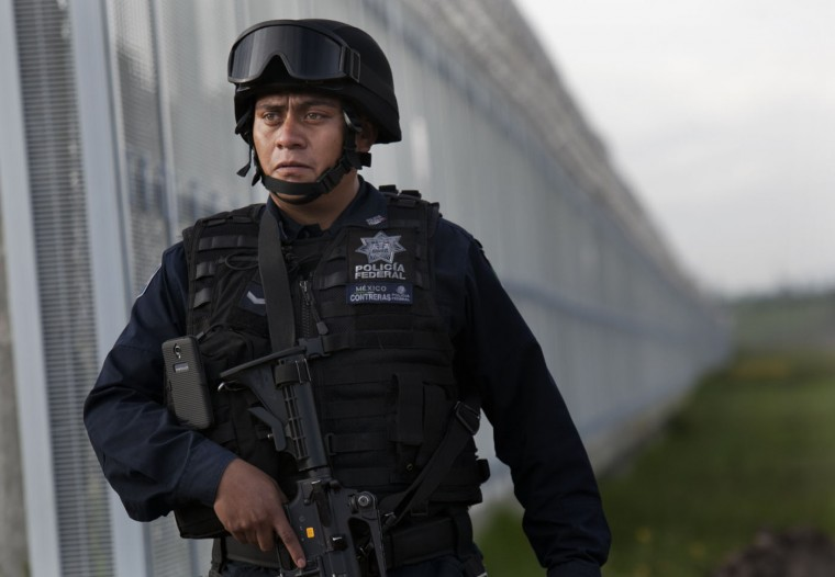 "Federal police patrol near the Altiplano maximum security prison in Almoloya, Toluca, Mexico, early Sunday, July 12, 2015. Mexico's most powerful drug lord, Joaquin ""El Chapo"" Guzman, escaped on Saturday night from a maximum security prison through a tunnel that opened into the shower area of his cell, the country's top security official announced. (AP Photo/Marco Ugarte)"
