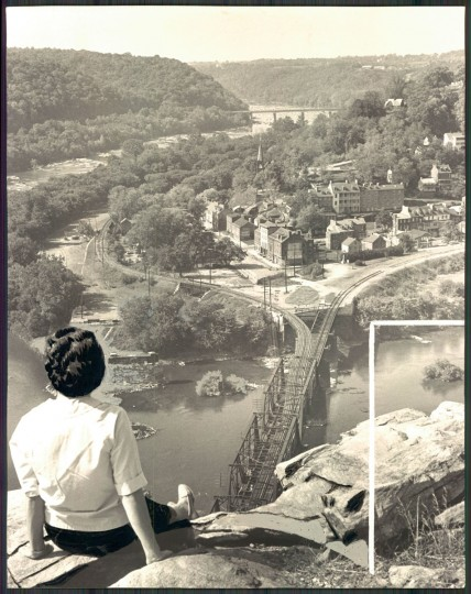 A U.S. Park Service official sits atop a stone wall, all that remains today of a Union fort which held 3,000 men during the Civil War on Maryland Heights at Harpers Ferry. (Clarence B. Garrett/Baltimore Sun, 1965)