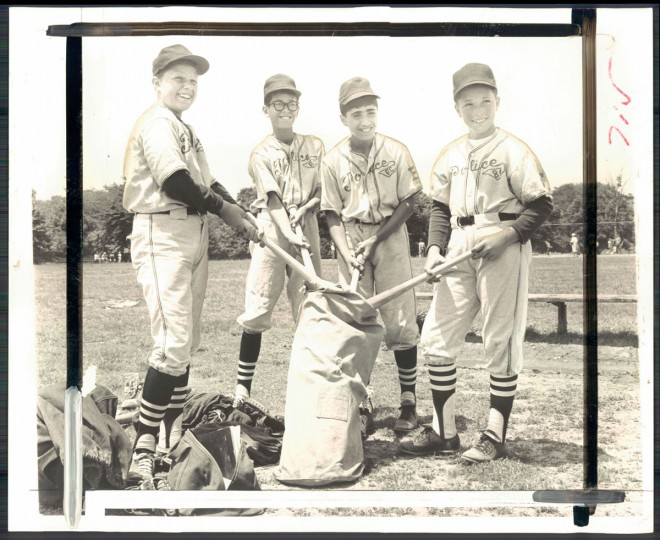 Sandy Milio, Vince Pompa, Tom Pompa and Michael Buenger - Southeast Police Boys stars unload bats before Baltimore Cub game at Patterson. (Ralph Robinson/Baltimore Sun, 1965)