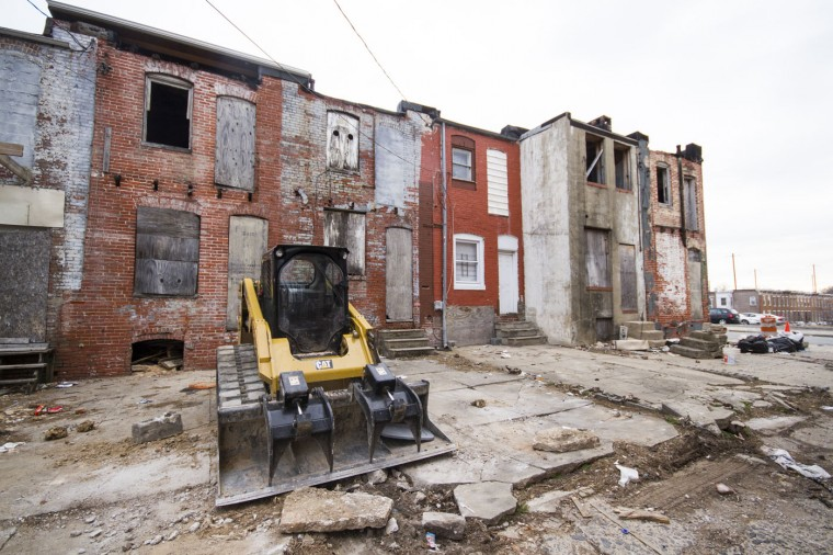 The backs of the south end of the 2400 block of E. Eager Street in East Baltimore, perpendicular to the 900 block of N. Port Street. (Kalani Gordon, Baltimore Sun)
