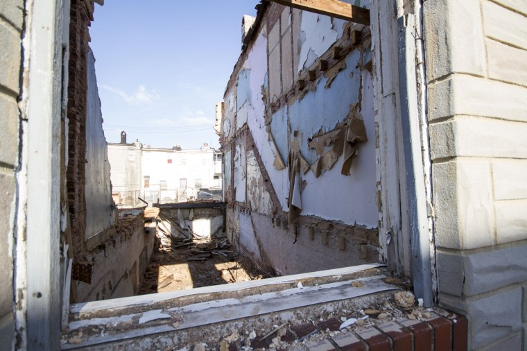 A nearly-gutted rowhome is seen at the tail-end of a months-long deconstruction project from Details. (Kalani Gordon, Baltimore Sun)