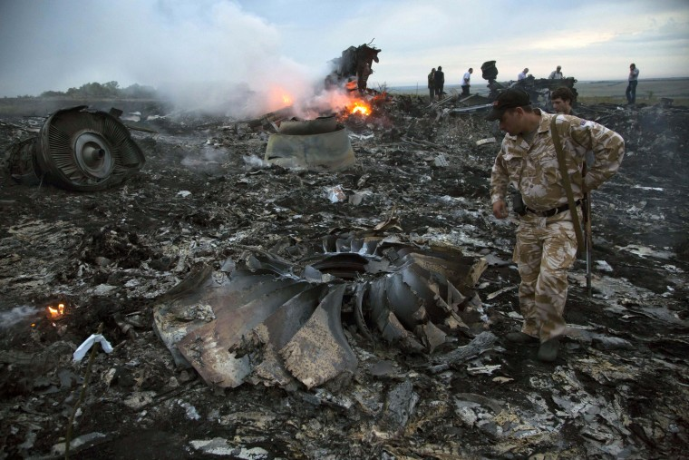July 17, 2014: The Malaysia Airlines Flight 17 passenger plane crashed near the village of Grabovo, Ukraine, killing all 298 people on board. It was later discovered that the plane had been shot down. (AP Photo/Dmitry Lovetsky, File)