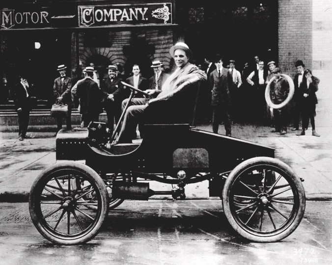 July 20, 1903: The Ford Motor Co. shipped its first car ever on July 20, 1903. In this file photo of Henry Ford, the industry pioneer sits on one of his early models.