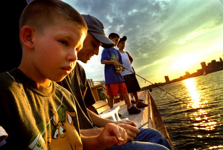 June 26, 2002: Zack Sinsky fishes with friends on a beautiful sunset evening at Tide Point pier. (Monica Lopossay Riesser, Baltimore Sun)