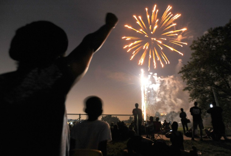 Fireworks in Towson, July 5. Photo taken with Nikon D700. The f-stop was set at f/2.8, the ISO at 2500 and the focal length at 17mm. The exposure time was 0.3 seconds. (Steve Ruark/For The Baltimore Sun)