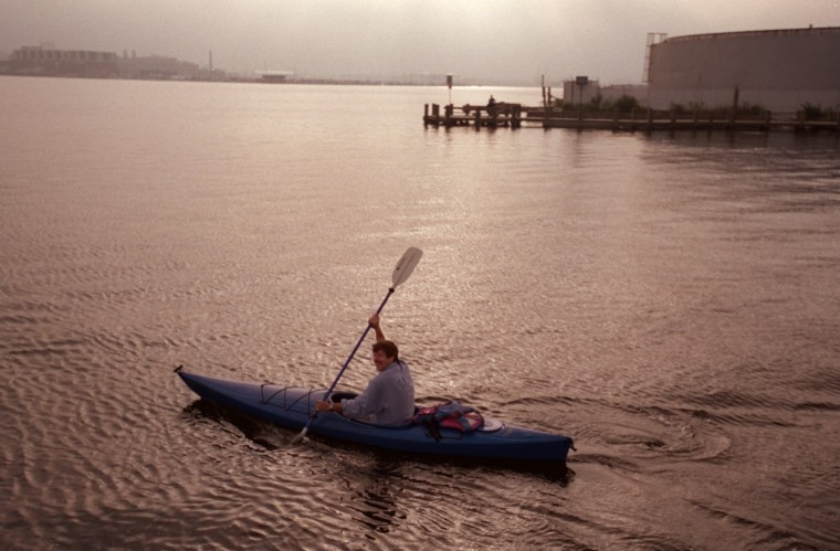 Sept. 12, 2000: Developer Bill Struever kayaks from the Tide Point office complex his company is building in Locust Point to a meeting in Canton. (Perry Thorsvik/Staff)