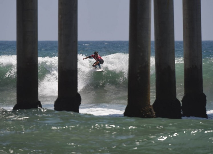 Professional surfer Tim Reyes of the US competes during his round two men's heat of the US Open of Surfing in Huntington Beach, California on July 29, 2015. The event celebrates it's 56th year beside the historic Huntington Pier which is considered the birthplace of California's surfing culture. (Mark Ralston/Getty Images)