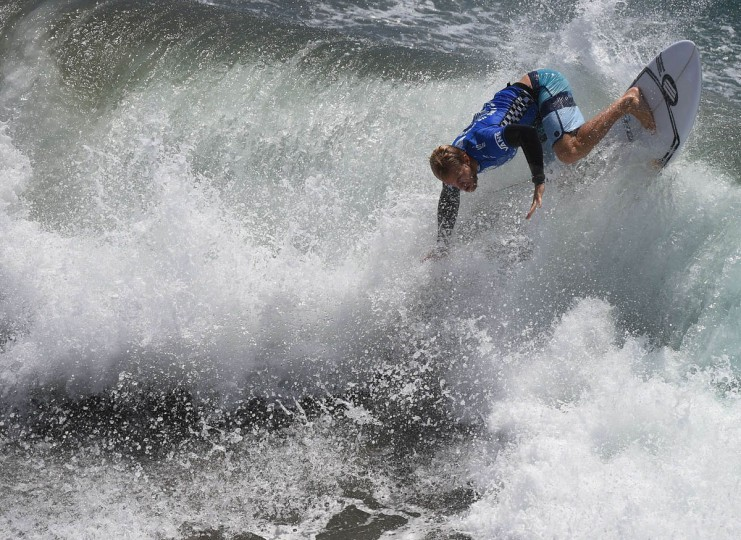 Professional surfer Adam Melling of Australia competes during his round two men's heat of the US Open of Surfing in Huntington Beach, California on July 29, 2015. The event celebrates it's 56th year beside the historic Huntington Pier which is considered the birthplace of California's surfing culture. (Mark Ralston/Getty Images)