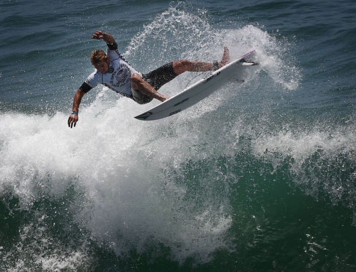 Professional surfer Joan Duru of France competes during his round two men's heat of the US Open of Surfing in Huntington Beach, California on July 29, 2015. The event celebrates it's 56th year beside the historic Huntington Pier which is considered the birthplace of California's surfing culture. (Mark Ralston/Getty Images)