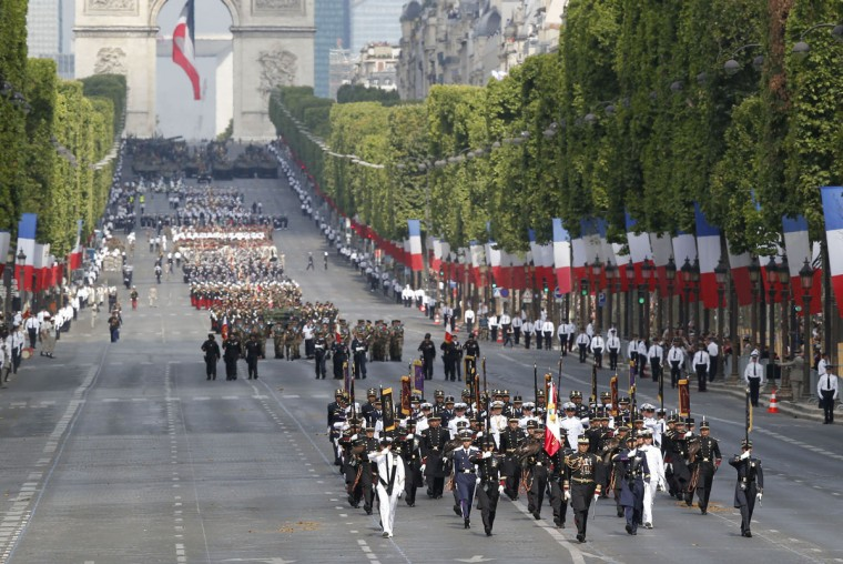 Mexican troops, walk down the Champs-Elysees avenue as part of Bastille Day parade Tuesday, July 14, 2015, in Paris, France. (AP Photo/Michel Euler)