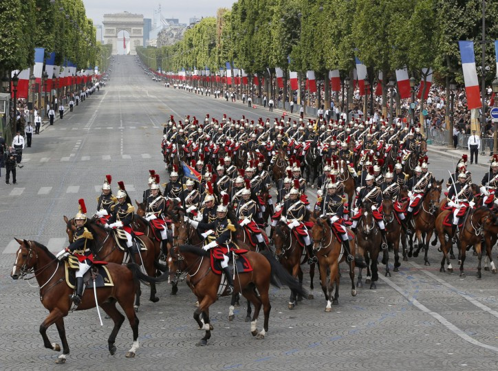 Mounted Republican Guards ride down the Champs-Elysees avenue during the Bastille Day parade Tuesday, July 14, 2015, in Paris, France. France is celebrating Bastille Day with a display of fighter jets and with anti-terrorist forces marching in the yearly parade in Paris for the first time as the country's leadership tries to show its muscle against extremists. (AP Photo/Michel Euler)