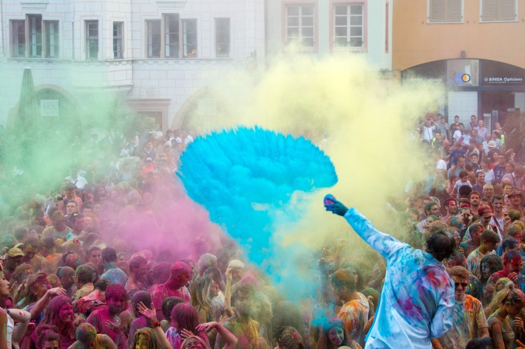 People take part in a color battle organized by the Artonik company during a street theater festival in Mulhouse on July 18, 2015. ( Sebastian Bozon/AFP-Getty Images)