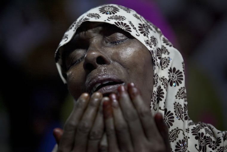 A woman cries as she prays at Baitul Mukarram, the National Mosque, on Eid Al-Fitr July 18, 2015 in Dhaka, Bangladesh. Muslims around the world are celebrating Eid Al-Fitr, which marks the end of the holy fasting month of Ramadan. (Allison Joyce/Getty Images)