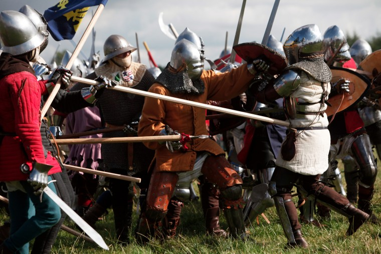 People fight during a reenactment of the Battle of Agincourt, in Agincourt, northern France, Saturday, July 25, 2015. The French are hosting a reenactment of the clash with England this weekend. More than 800 people in Medieval garb are gathering at the site to commemorate the battle, which was a turning point in the Hundred Years' War. (Associated Press/Thibault Camus) ORG XMIT: XTC121