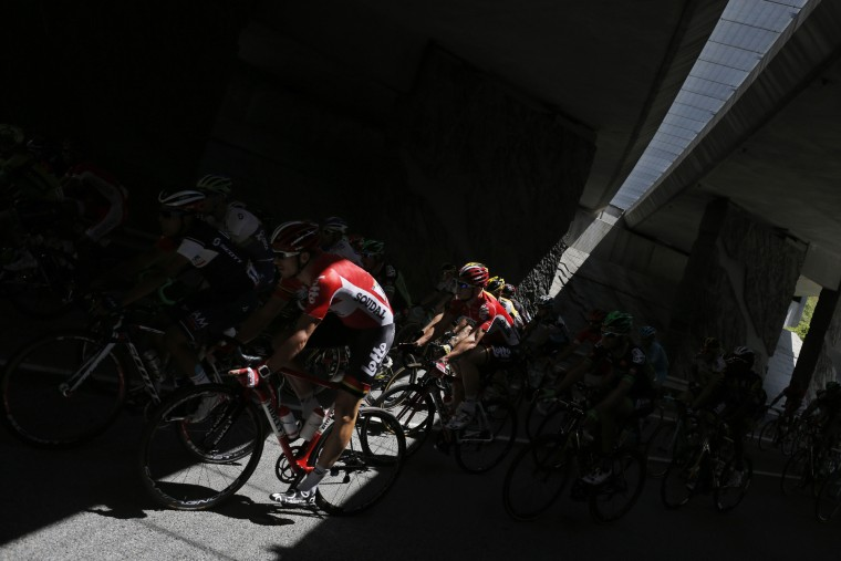 The pack passes through a tunnel during the twentieth stage of the Tour de France cycling race over 110.5 kilometers (68.7 miles) with start in Modane and finish in Alpe d'Huez, France, Saturday, July 25, 2015. (Associated Press/Laurent Cipriani)