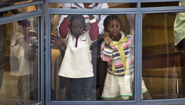 Two Kenyan children look out from an upper level in the reopened Westgate Shopping Mall, nearly two years after a terrorist attack there left at least 67 people dead, in the capital Nairobi, Kenya Saturday, July 18, 2015. Hundreds of shoppers thronged through the reopened mall Saturday, following two years of repairs after security forces battled four gunmen from Somalia's al-Qaida-linked al-Shabab militant group there in September 2013. (Ben Curtis/Associated Press)