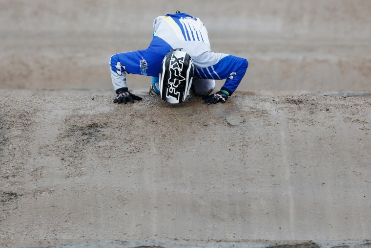 Exequiel Torres of Argentina celebrates by kissing the dirt track after winning the Men Junior motos race during day 5 of the UCI BMX World Championships at on July 25, 2015 in Zolder, Belgium. (Dean Mouhtaropoulos/Getty Images)