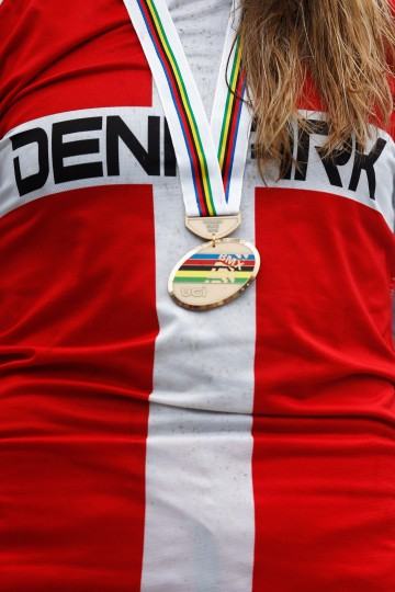 Simone Christensen of Denmark poses with her bronze medal on the podium after the Women Elite motos race during day 5 of the UCI BMX World Championships at on July 25, 2015 in Zolder, Belgium. (Dean Mouhtaropoulos/Getty Images)
