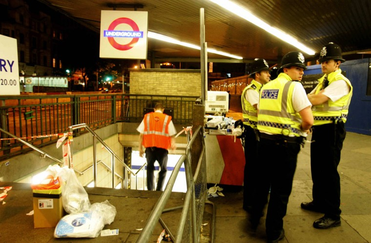 British police guard the entrance of Kings Cross station, where a bomb went off inside the station's tube network on July 7, 2005. (CARL DE SOUZA/AFP/Getty Images)