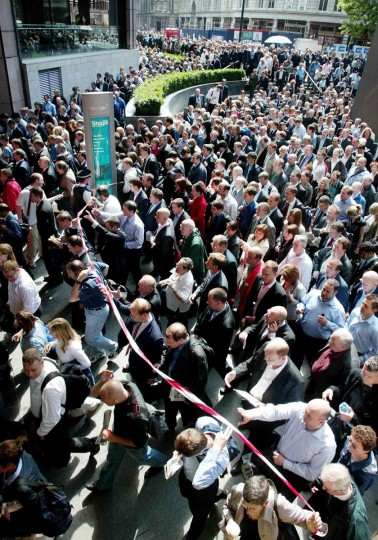 Commuters surge toward Liverpool Street Station as it re-opens July 7, 2005, after a terror attack earlier in the morning, when a bomb exploded in the tunnel near the station. (AP Photo/Gareth Fuller/PA)