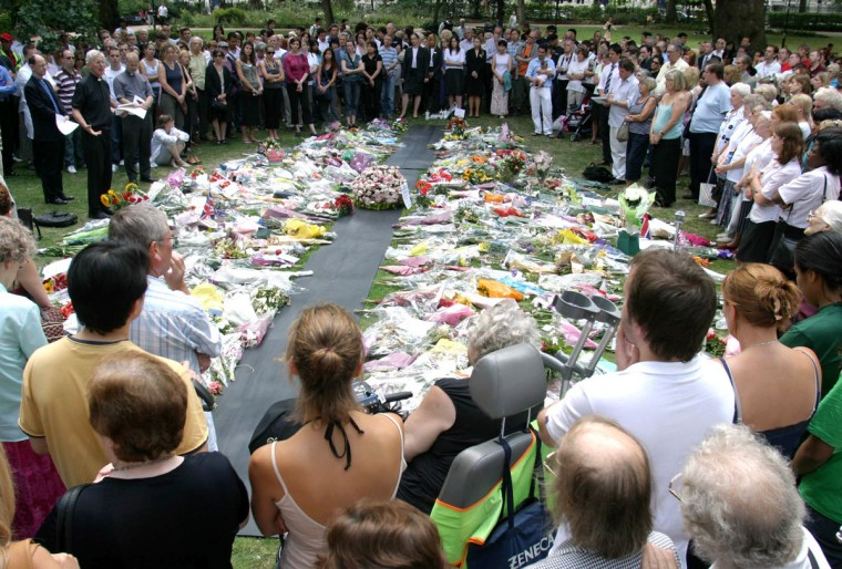 Hundreds of locals and visitors mourn the 53 confirmed dead during an Act of Remembrance ceremony at Russell Square Gardens, in London, Friday, July 15, 2005. (AP Photo/Sergio Dionisio)