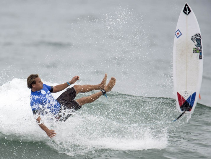 Chris Ward slips and falls from his board during Day 3 of the U.S. Open surfing competition at Huntington Beach, Calif. (Kyusung Gong/AP photo)