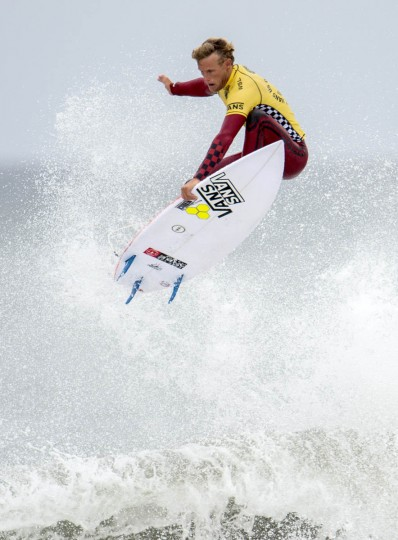 Pat Gudauskas leaps off a wave during Day 3 of the U.S. Open surfing competition at Huntington Beach, Calif. (Kyusung Gong/AP photo)