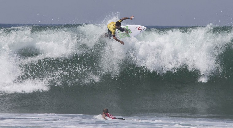 Mason Ho, of Hawaii, floats high across a wave in a Round 1 heat during the U.S. Open of Surfing in Huntington Beach, Calif., on Tuesday, July 28, 2015. (Allen J. Schaben/Los Angeles Times)