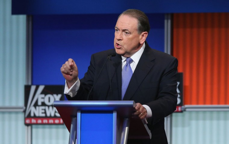 Republican presidential candidate Mike Huckabee fields a question during the first Republican presidential debate hosted by Fox News and Facebook at the Quicken Loans Arena on August 6, 2015 in Cleveland, Ohio. The top ten GOP candidates were selected to participate in the debate based on their rank in an average of the five most recent political polls. (Photo by Scott Olson/Getty Images)