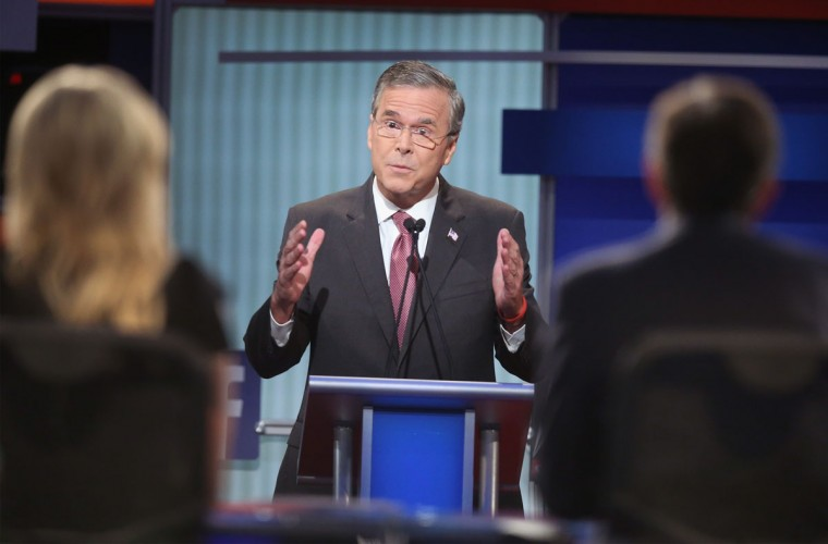 Republican presidential candidate Jeb Bush fields a question during the first Republican presidential debate hosted by Fox News and Facebook at the Quicken Loans Arena on August 6, 2015 in Cleveland, Ohio. The top ten GOP candidates were selected to participate in the debate based on their rank in an average of the five most recent political polls. (Photo by Scott Olson/Getty Images)