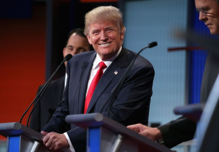 Republican presidential candidate Donald Trump participates in the first prime-time presidential debate hosted by FOX News and Facebook at the Quicken Loans Arena August 6, 2015 in Cleveland, Ohio. The top-ten GOP candidates were selected to participate in the debate based on their rank in an average of the five most recent national political polls. (Photo by Chip Somodevilla/Getty Images)