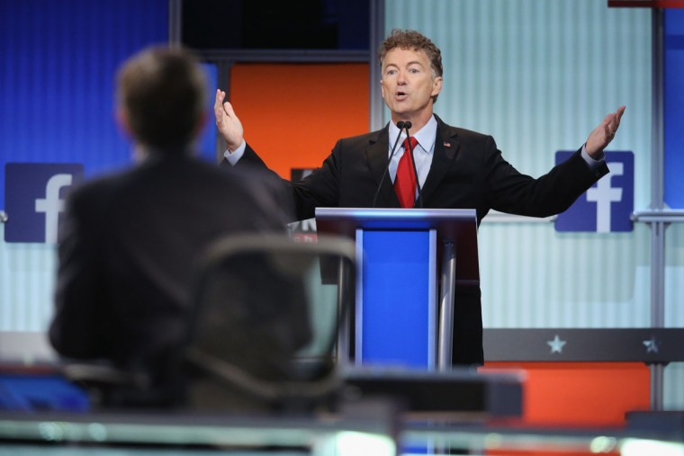 Republican presidential candidate Sen. Rand Paul (R-KY) fields a question during the first Republican presidential debate hosted by Fox News and Facebook at the Quicken Loans Arena on August 6, 2015 in Cleveland, Ohio. The top ten GOP candidates were selected to participate in the debate based on their rank in an average of the five most recent political polls. (Photo by Scott Olson/Getty Images)