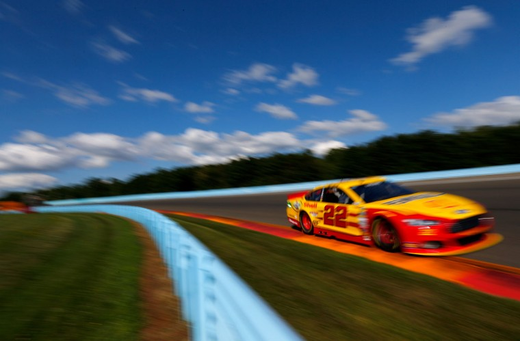 Joey Logano, driver of the #22 Shell Pennzoil Ford, practices for the NASCAR Sprint Cup Series Cheez-It 355 at Watkins Glen International on August 7, 2015 in Watkins Glen, New York. (Jonathan Ferrey/Getty Images)