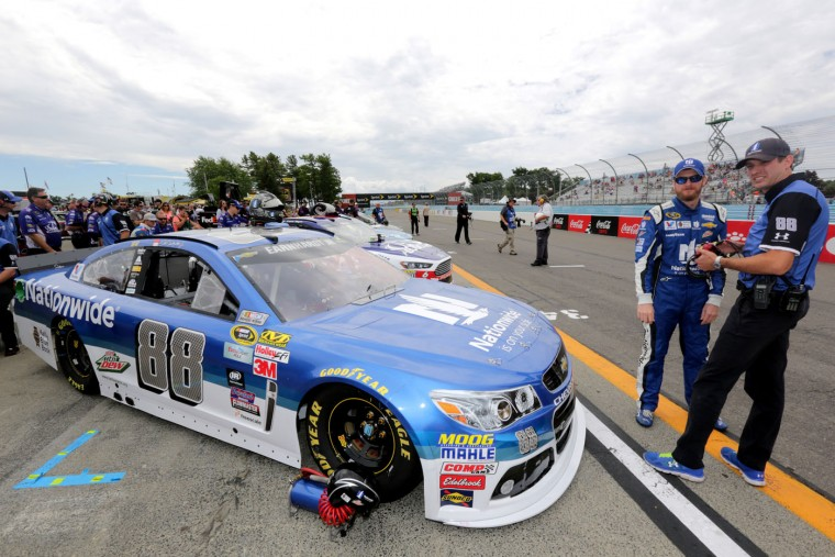Dale Earnhardt Jr., driver of the #88 Nationwide Chevrolet, talks to his crew chief Greg Ives during qualifying for the NASCAR Sprint Cup Series Cheez-It 355 at Watkins Glen International on August 8, 2015 in Watkins Glen, New York. (Jerry Markland/Getty Images)