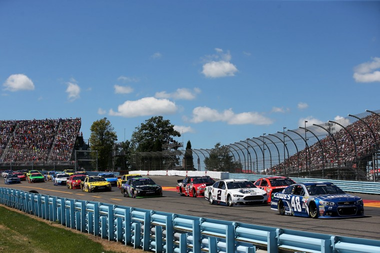 Jimmie Johnson, driver of the #48 Lowe's Chevrolet, leads a pack of cars during the NASCAR Sprint Cup Series Cheez-It 355 at the Glen at Watkins Glen International on August 9, 2015 in Watkins Glen, New York. (Chris Graythen/Getty Images)