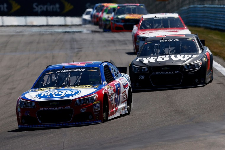 AJ Allmendinger, driver of the #47 Kroger/Bush's Beans Chevrolet, leads a pack of cars during the NASCAR Sprint Cup Series Cheez-It 355 at the Glen at Watkins Glen International on August 9, 2015 in Watkins Glen, New York. (Jeff Zelevansky/Getty Images)