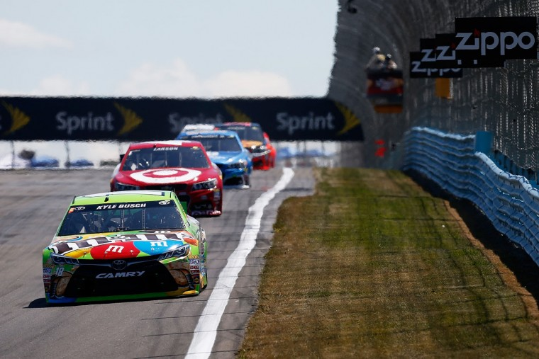 Kyle Busch, driver of the #18 M&M Crispy Toyota, leads a pack of cars during the NASCAR Sprint Cup Series Cheez-It 355 at the Glen at Watkins Glen International on August 9, 2015 in Watkins Glen, New York. (Jeff Zelevansky/Getty Images)